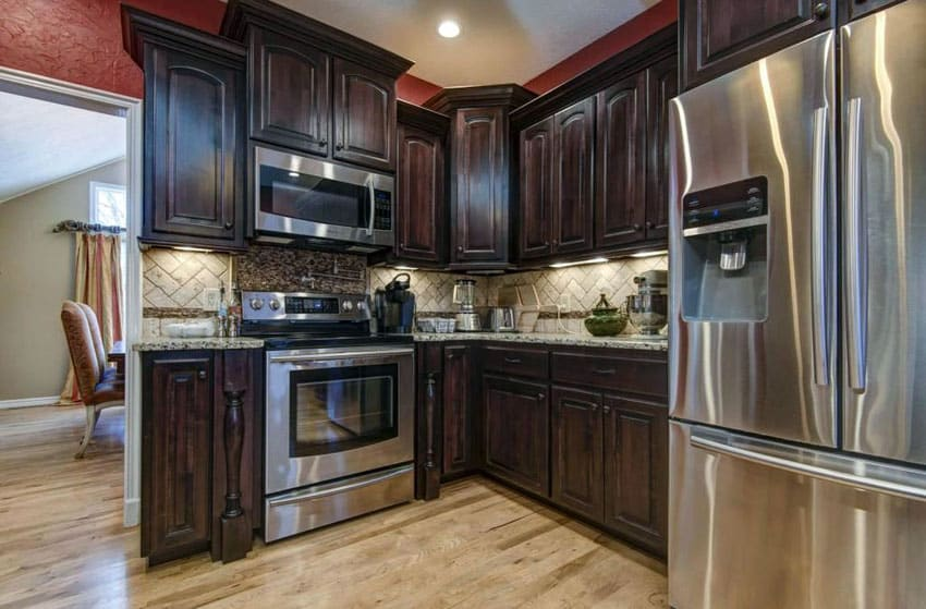Small l shaped kitchen with custom cabinetry with dark wood finish