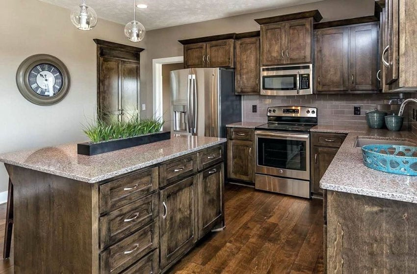 Traditional kitchen with dark craftsman style cabinetry and quartz countertops