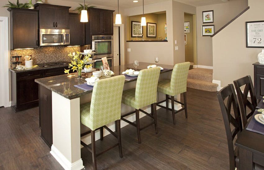 Traditional kitchen with dark wood flat panel cabinets and island