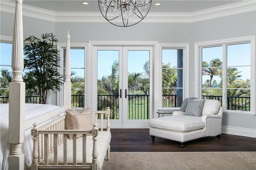 Traditional master bedroom walnut hardwood floors and golf course views