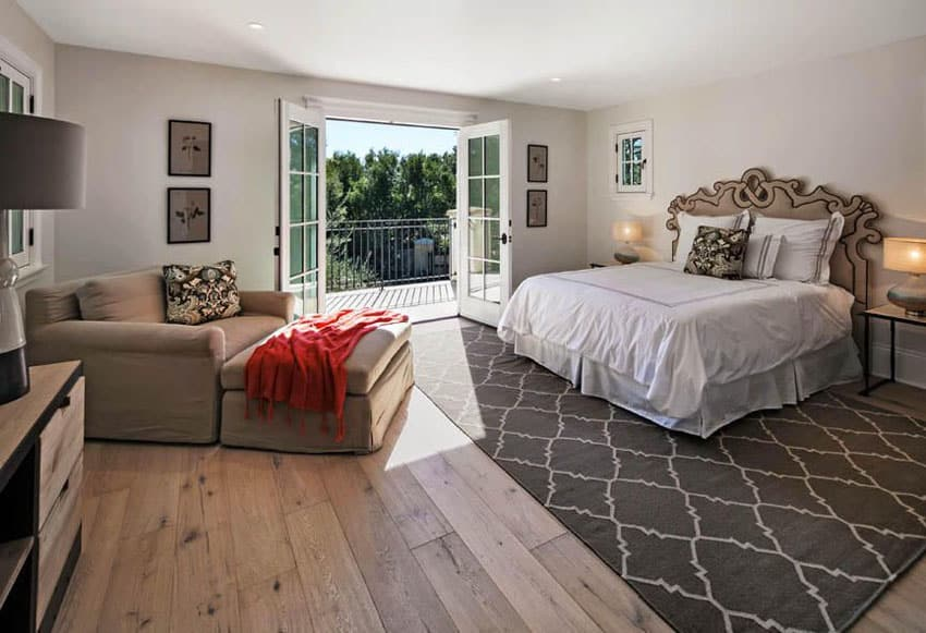 Traditional master bedroom with light color hickory wide plank flooring