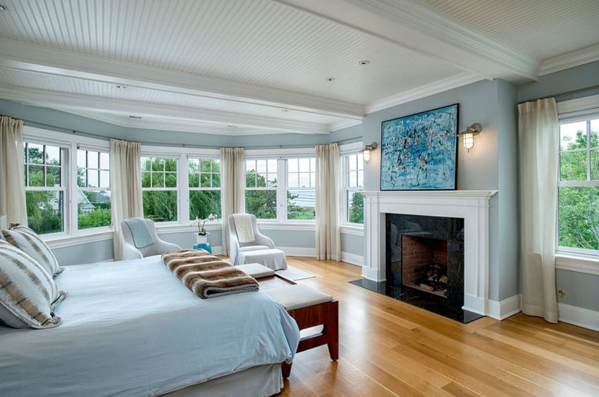 Traditional master bedroom with light wood floors