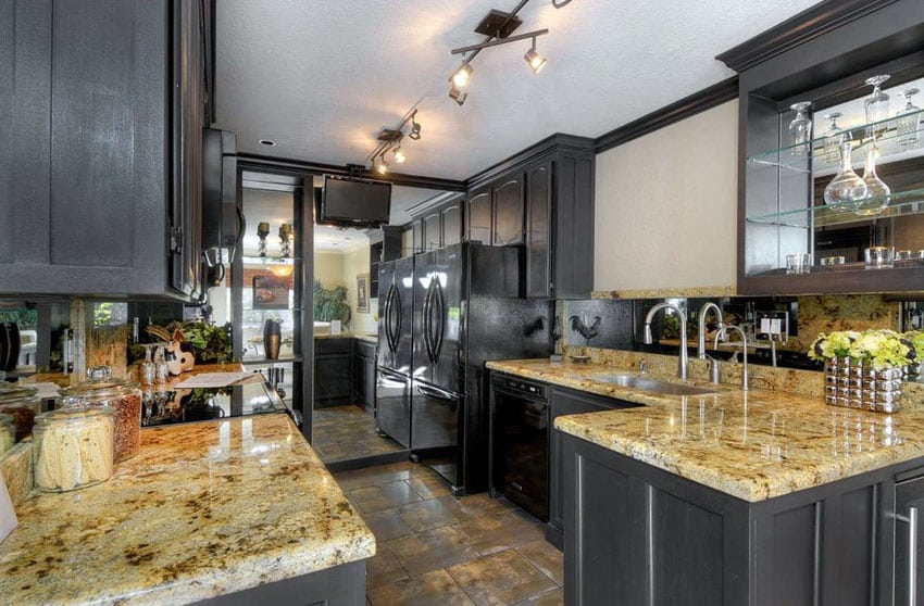 Transitional kitchen with dark cabinets cream granite counters and large mirror