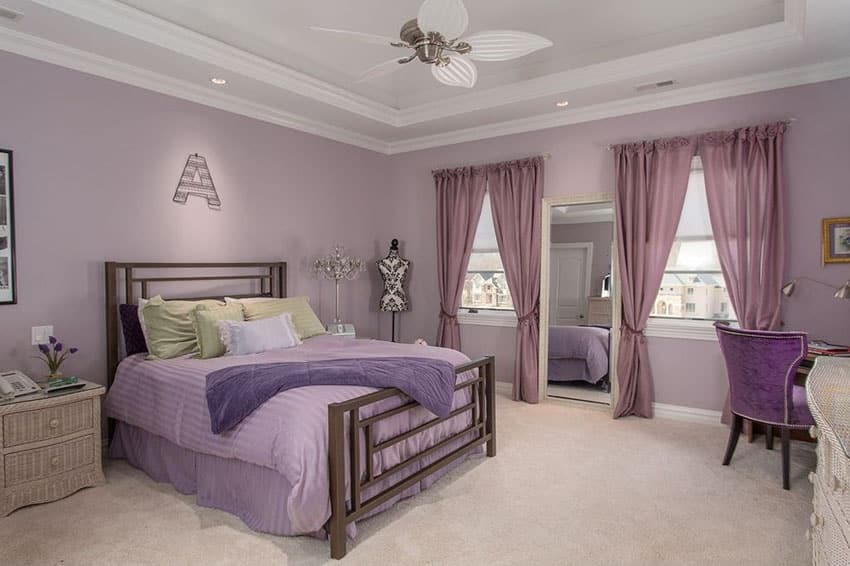 Beautiful purple girls bedroom with white tray ceiling and beige carpet