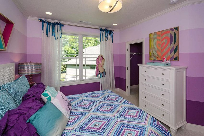 Colorful girls bedroom with shades of purple painted walls