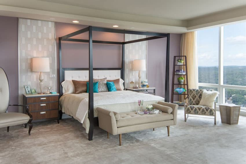 Contemporary bedroom with purple painted walls with cream accent detail panels and modern four post canopy bed
