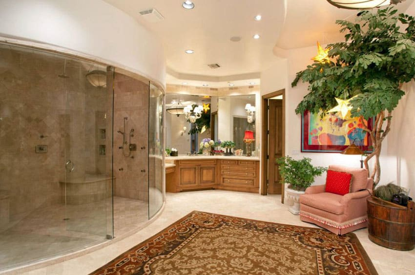 Craftsman bathroom with curved glass shower enclosure with travertine tiles