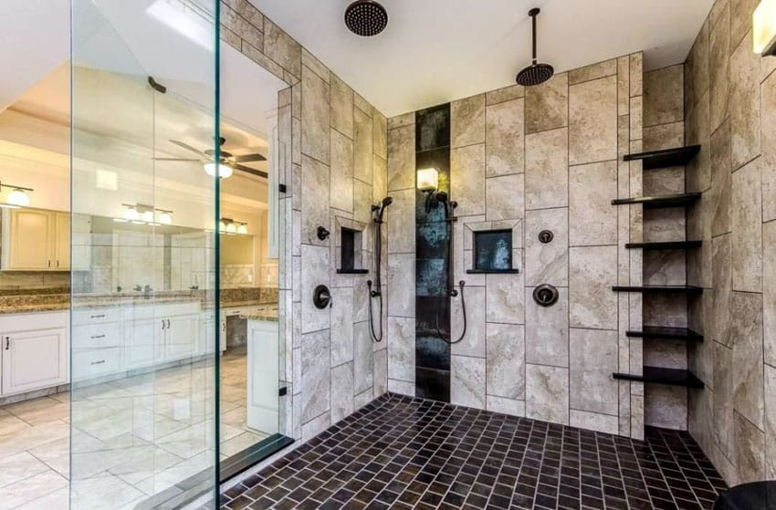 Large travertine shower with rainfall showerhead and subway floor tile