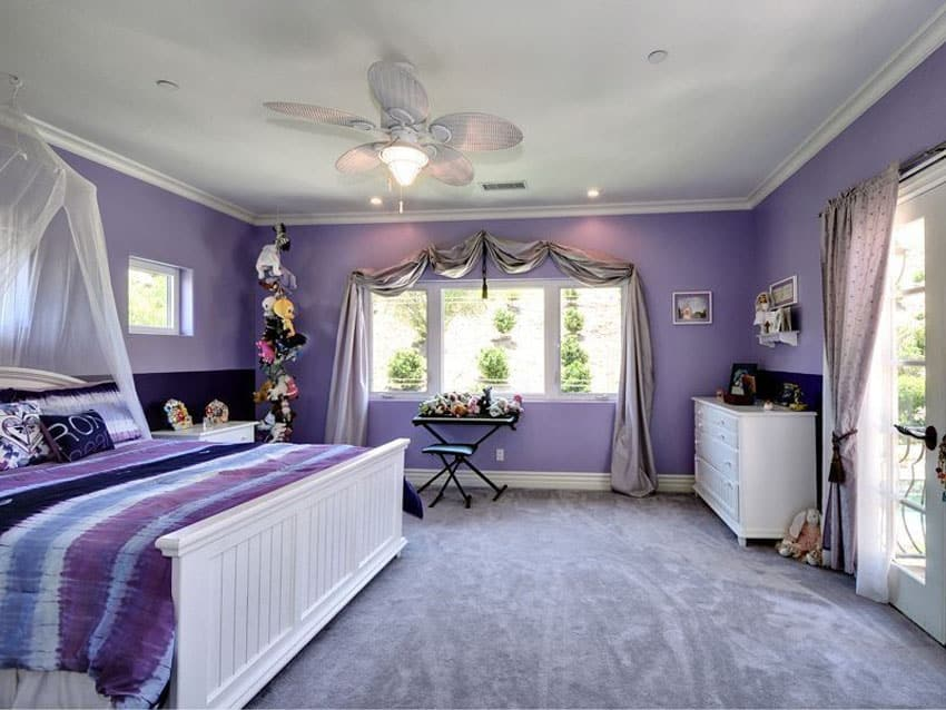 Lavender color kids room with white canopy bed and furniture