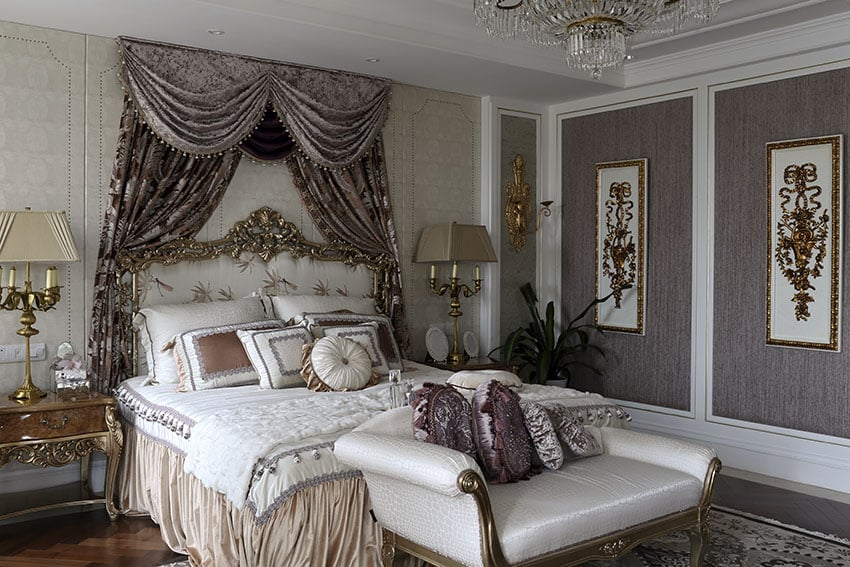 Luxury french provincial bedroom with gold gilded furniture and purple wall panels and decor