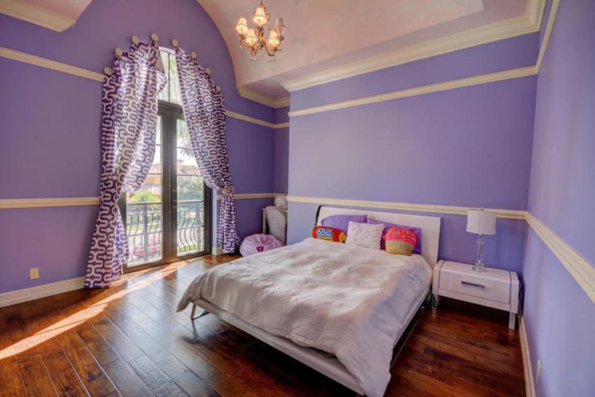 Purple girls bedroom with wood floors and solitude paint with cream molding