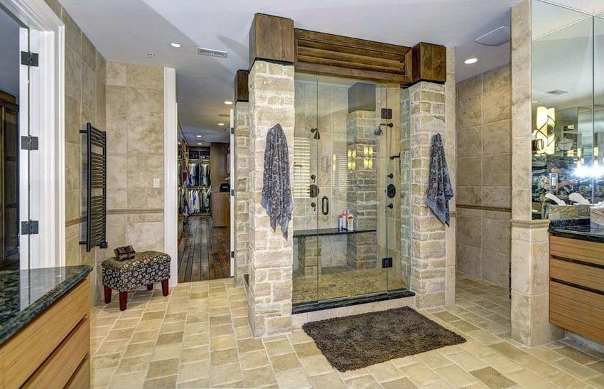 Rustic bathroom with travertine shower with glass door