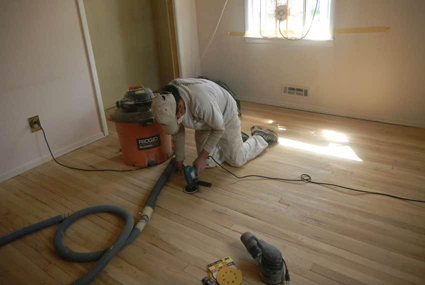 Sand water damaged wood floor