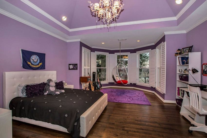 Teens bedroom in purple with swinging bench and wood floors