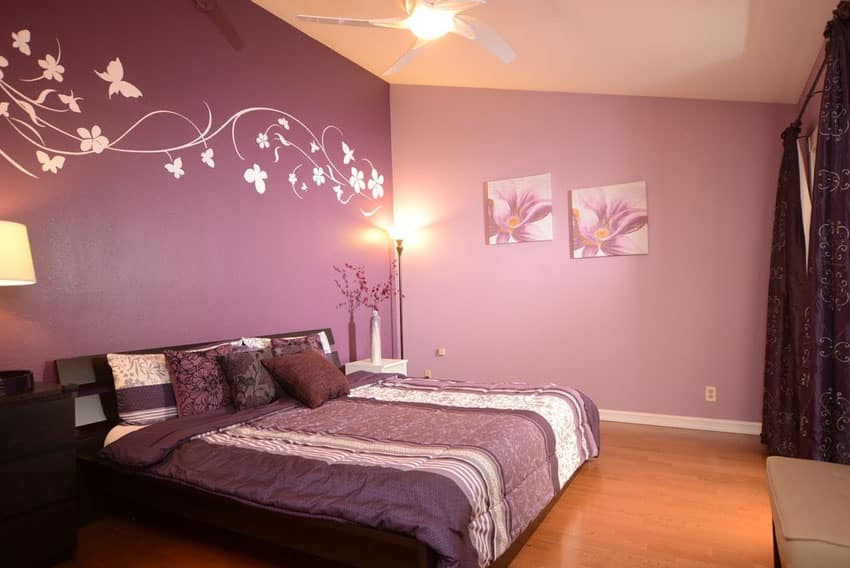 Two tone purple bedroom with wall decals and curtains and bed comforter
